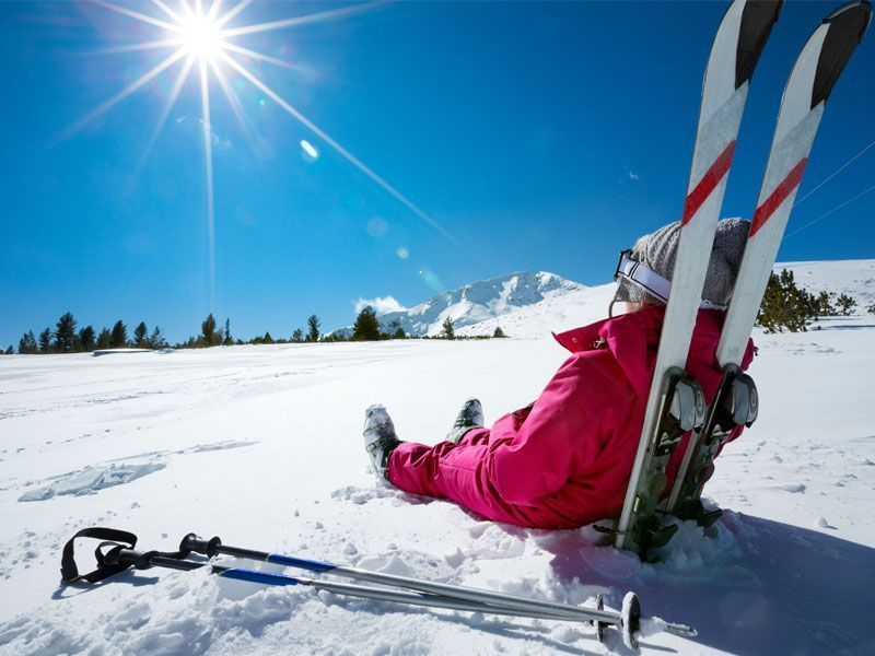 Woman relaxing on the ski slopes of Alleghe