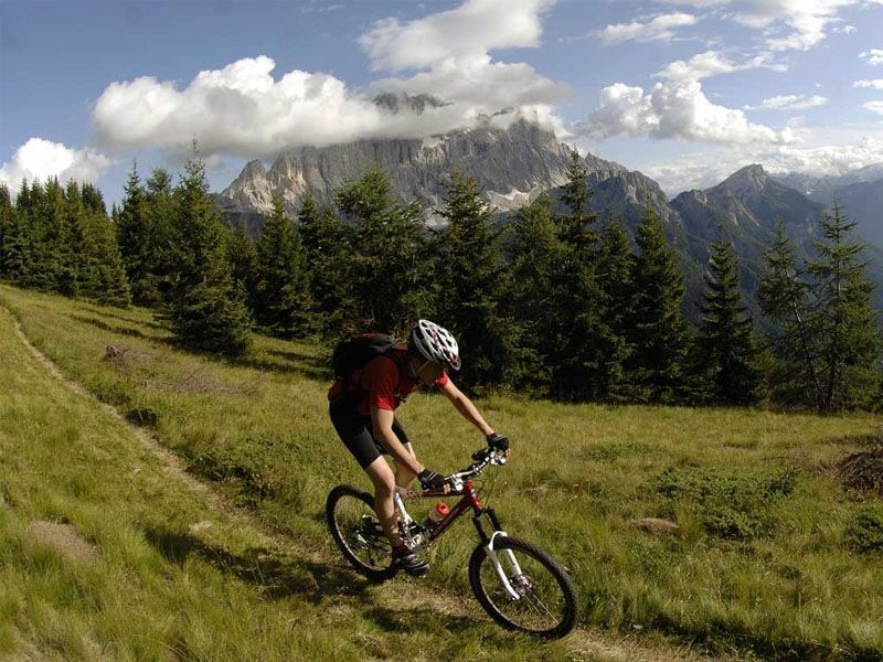 Man who is cycling in the mountains in Alleghe